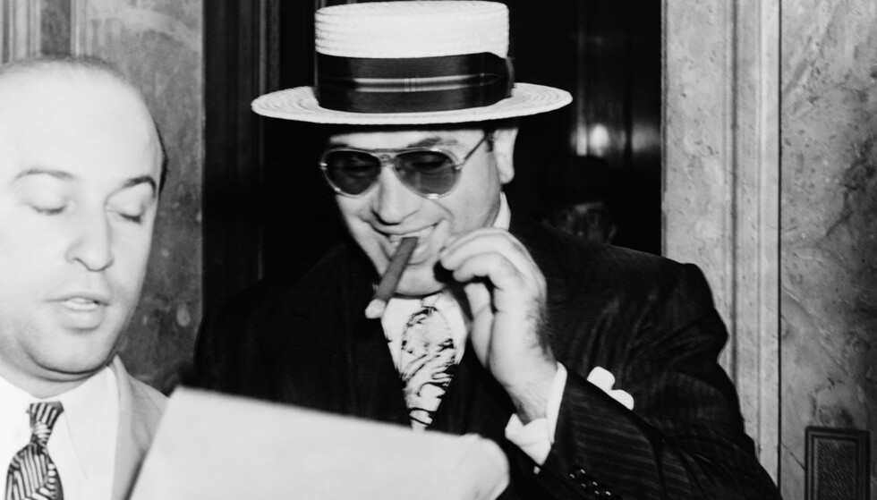 Mandatory Credit: Photo by Granger/REX (8639320a) Al Capone (1899-1947). American Gangster. Photographed Leaving The Federal Building In Miami, Florida, With His Lawyer Abe Teitelbaum, 1941. Al Capone (1899-1947).